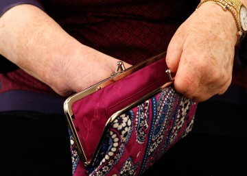Another close up shot of Cindy's hands with an open kiss clasp purse.