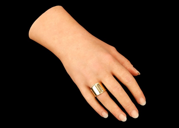 Top side of the right cosmetic hand with ring.