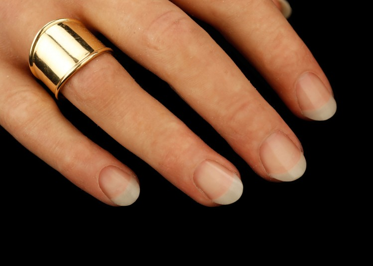 Close up of top side of right cosmetic hand, with view of fingernails and some fingers, including the one with the ring on it.