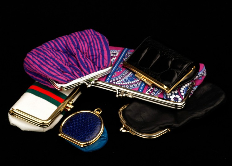 Another studio shot of the kiss-clasp handbags: six here, of varied shapes and colors.
